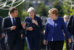 German Chancellor Angela Merkel, right, speaks with French President Emmanuel Macron, left, and British Prime Minister Theresa May after meeting at a hotel on the sidelines of the EU-Western Balkans summit in Sofia, Bulgaria, Thursday, May 17, 2018. (AP Photo/Darko Vojinovic)