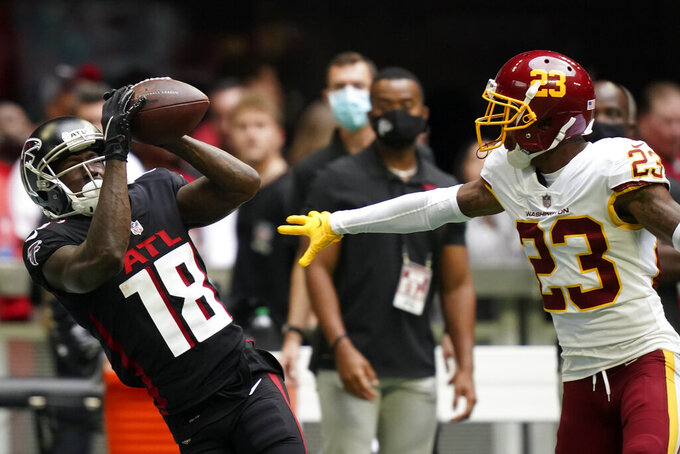 Atlanta Falcons wide receiver Calvin Ridley (18) misses the catch against Washington Football Team cornerback William Jackson (23) during the first half of an NFL football game, Sunday, Oct. 3, 2021, in Atlanta. (AP Photo/Brynn Anderson)