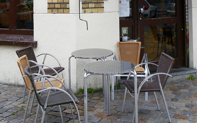 FILE - In this file photo dated Thursday, Oct.8, 2020, empty tables at a cafe terrace in Lille, northern France.  The Paris prosecutor's office on Monday April 5, 2021, announced an investigation into accusations that government ministers and others dined in secret unidentified restaurants in violation of pandemic restrictions.  (AP Photo/Michel Spingler, FILE)