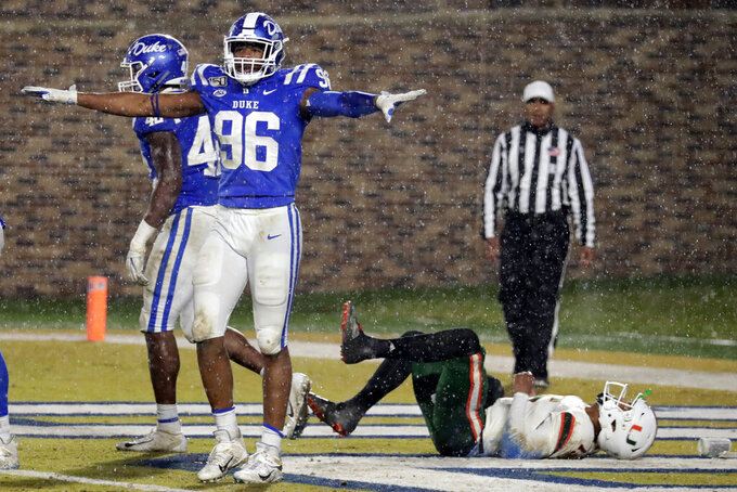 Duke's Chris Rumph II (96) celebrates in front of Miami's Jarren Williams (15) after Duke made a defensive stop during the third quarter of an NCAA college football game in Durham, N.C., Saturday, Nov. 30, 2019. (AP Photo/Chris Seward)