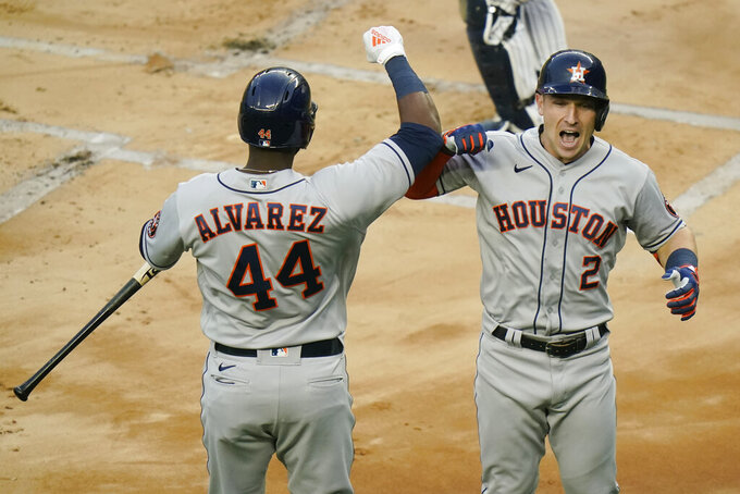 Houston Astros' Alex Bregman, right, celebrates with Yordan Alvarez, left,  after hitting a home run during the first inning of a baseball game against the New York Yankees Tuesday, May 4, 2021, in New York. (AP Photo/Frank Franklin II)