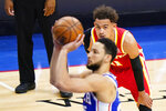 Atlanta Hawks' Trae Young, right, watches as Philadelphia 76ers' Ben Simmons attempts a free-throw during the first half of Game 5 in a second-round NBA basketball playoff series, Wednesday, June 16, 2021, in Philadelphia. (AP Photo/Matt Slocum)