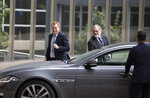 United Kingdom's Brexit advisor David Frost, left, and British Ambassador to the EU Tim Barrow, center, arrive at EU headquarters for a technical meeting on Brexit in Brussels, Wednesday, Sept. 11, 2019. (AP Photo/Virginia Mayo)