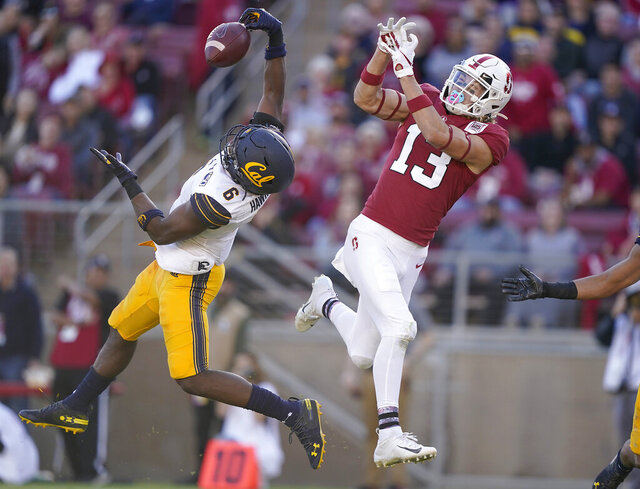 California safety Jaylinn Hawkins (6) intercepts a pass for Stanford wide receiver Simi Fehoko (13) during the second half of an NCAA college football game Saturday, Nov. 23, 2019 in Stanford, Calif. (AP Photo/Tony Avelar)