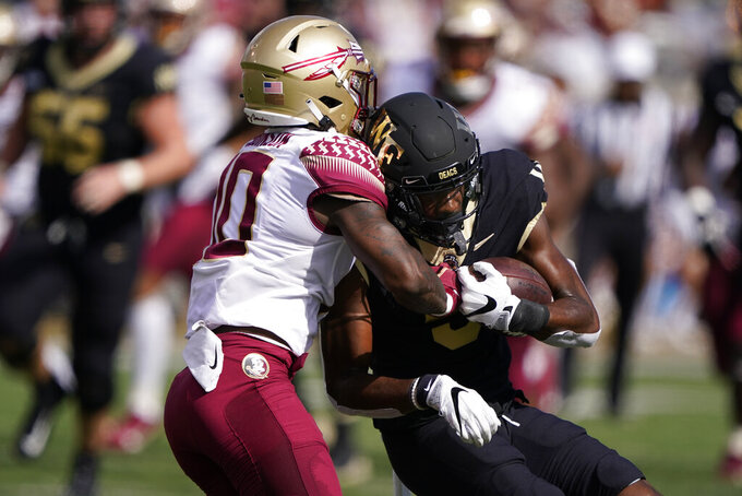 Florida State defensive back Jammie Robinson, left, strips the ball away from Wake Forest wide receiver Jaquarii Roberson during the first half of an NCAA college football game Saturday, Sept. 18, 2021, in Winston-Salem, N.C. (AP Photo/Chris Carlson)