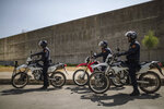Security forces stand guard as suspects charged in connection with the killing of two Scandinavian tourists in Morocco's Atlas Mountains, arrive for a final trial session in Sale, near Rabat, Morocco, Thursday, July 18, 2019. The three main defendants in the brutal slaying of two female Scandinavian hikers have asked for forgiveness from Allah ahead of a verdict. (AP Photo/Mosa'ab Elshamy)