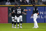 The Chicago White Sox outfielders Eloy Jimenez, Leury Garcia and Luis Robert, from left, celebrate the team's 9-3 win over the Los Angeles Angels in a baseball game Tuesday, Sept. 14, 2021, in Chicago. (AP Photo/Charles Rex Arbogast)