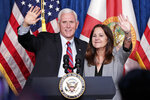 Vice President Mike Pence, left, and his wife Karen greet supporters at a campaign event Thursday, Jan. 16, 2020, in Kissimmee, Fla. (AP Photo/John Raoux)