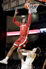 Alabama forward Herbert Jones (1) scores over Vanderbilt guard Scotty Pippen Jr. in the second half of an NCAA college basketball game Wednesday, Jan. 22, 2020, in Nashville, Tenn. (AP Photo/Mark Humphrey)
