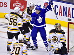 Toronto Maple Leafs left wing Trevor Moore (42) celebrates his goal on Boston Bruins goaltender Tuukka Rask (40) during second period NHL playoff hockey action in Toronto, on Monday, April 15, 2019. (Frank Gunn/The Canadian Press via AP)