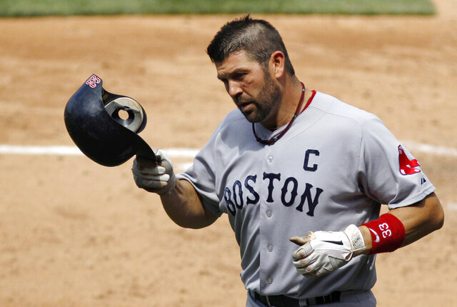 "FILE - In this June 30, 2011, file photo, Boston Red Sox's Jason Varitek trots back to the dugout after hitting a home run off Philadelphia Phillies relief pitcher Drew Carpenter during a baseball game in Philadelphia. Three days after the Red Sox fired manager Alex Cora for his involvement in a cheating scandal, supporters pleaded for Boston's front office to hire former catcher and team captain Jason Varitek as manager. at a town hall event Friday, Jan. 17, during the team's winter festival. Members of the team's leadership group were hit with ""Hire 'Tek!"" chants throughout the night. (AP Photo/Matt Slocum, File)"