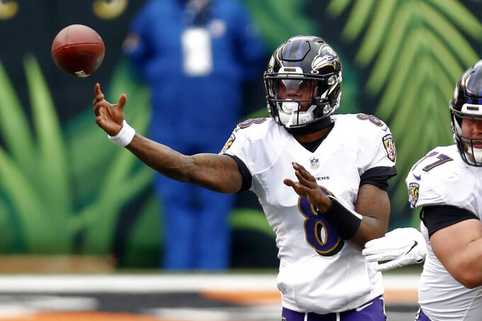 Baltimore Ravens quarterback Lamar Jackson (8) passes against the Cincinnati Bengals during the first half of an NFL football game, Sunday, Jan. 3, 2021, in Cincinnati. (AP Photo/Aaron Doster)