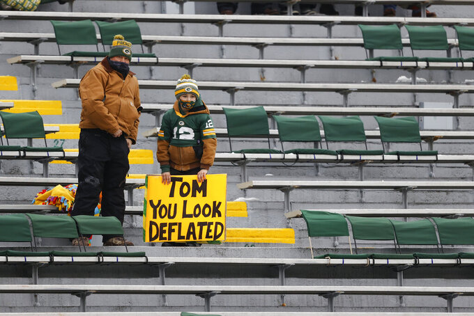 A young Packer supporter holds his sign before the NFC championship NFL football game between the Tampa Bay Buccaneers and Green Bay Packers in Green Bay, Wis., Sunday, Jan. 24, 2021. (AP Photo/Jeffrey Phelps)