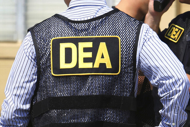 FILE - This June 13, 2016 file photo shows Drug Enforcement Administration (DEA) agents in Florida. A once-standout U.S. narcotics agent has admitted conspiring to launder money with a Colombian drug cartel. Jose Irizarry pleaded guilty Monday, Sept. 14, 2020 in Tampa, Fla., to federal bank fraud, conspiracy and other charges. (Joe Burbank/Orlando Sentinel via AP, File)