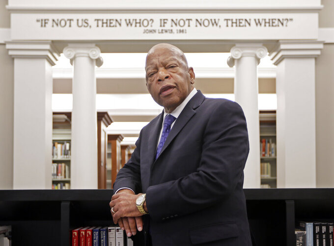 """FILE - This Nov. 18, 2016 file photo shows Rep. John Lewis, D-Ga., in the Civil Rights Room in the Nashville Public Library in Nashville, Tenn. The award-winning graphic novels about the congressmen and civil rights activist John Lewis will continue a year after his death. Abrams announced Tuesday that """"Run: Book One"""" will be published Aug. 3, just over a year after Lewis died at age 80. (AP Photo/Mark Humphrey, File)"""
