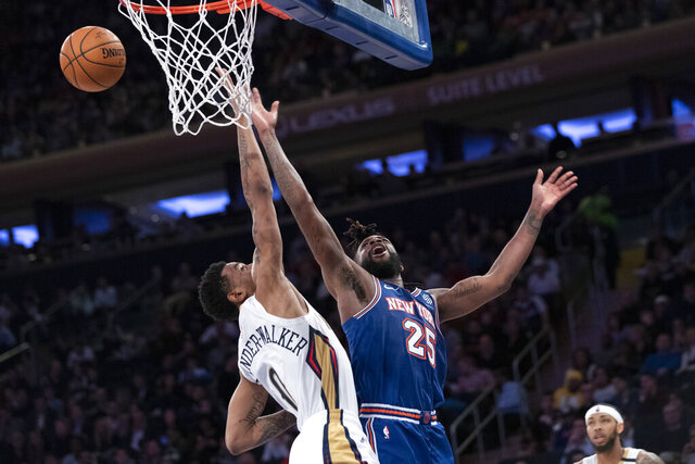 New Orleans Pelicans guard Nickeil Alexander-Walker (0) fouls New York Knicks guard Reggie Bullock (25) during the second half of an NBA basketball game, Friday, Jan. 10, 2020, at Madison Square Garden in New York. (AP Photo/Mary Altaffer)