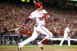 Washington Nationals' Juan Soto (22) drives in three runs with a single in the eighth inning to put the Washington Nationals up over the Milwaukee Brewers in a National League wild-card baseball game at Nationals Park, Tuesday, Oct. 1, 2019, in Washington. The Nationals won 4-3. (AP Photo/Andrew Harnik)