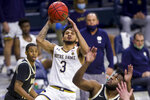 Notre Dame's Prentiss Hubb (3) goes up for a shot over Wake Forest's Isaiah Wilkins, right, during the second half of an NCAA college basketball game Tuesday, Feb. 2, 2021, in South Bend, Ind. Notre Dame won 79-58. (AP Photo/Robert Franklin)