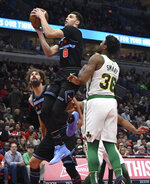 Chicago Bulls guard Zach LaVine (8) goes to the basket as Boston Celtics guard Marcus Smart (36) defends him during the first half of an NBA basketball game Saturday, Feb. 23, 2019, in Chicago. (AP Photo/David Banks)