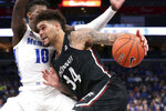 Memphis' guard Damion Baugh (10) defends Cincinnati's guard Jarron Cumberland (34) in the first half of an NCAA college basketball game Thursday, Jan. 16, 2020, in Memphis, Tenn. (AP Photo/Karen Pulfer Focht)