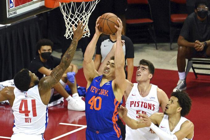 New York Knicks forward Reid Travis (40) shoots against the Detroit Pistons during the first half of an NBA summer league basketball game Friday, Aug. 13, 2021, in Las Vegas. (AP Photo/David Becker)