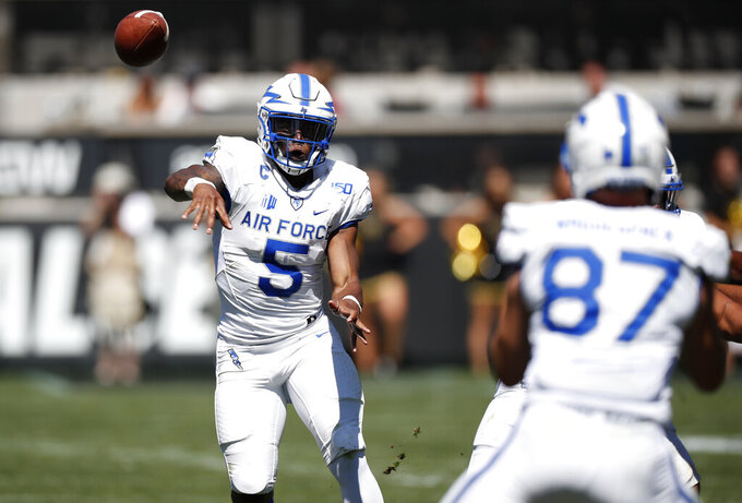 Air Force quarterback Donald Hammond III, back, throws a pass to tight end Kade Waguespack in the second half of an NCAA college football game against Colorado Saturday, Sept. 14, 2019, in Boulder, Colo. Air Force won 30-23 in overtime. (AP Photo/David Zalubowski)