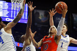 Auburn's Samir Doughty (10) shoots amid Kentucky defenders, from left to right, Nick Richards, Immanuel Quickley and Nate Sestina during the second half of an NCAA college basketball game in Lexington, Ky., Saturday, Feb. 29, 2020. (AP Photo/James Crisp)