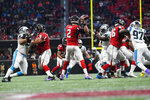 Atlanta Falcons quarterback Matt Ryan (2) passes the ball against the Carolina Panthers during the first half of an NFL football game, Sunday, Dec. 8, 2019, in Atlanta. (AP Photo/John Amis)