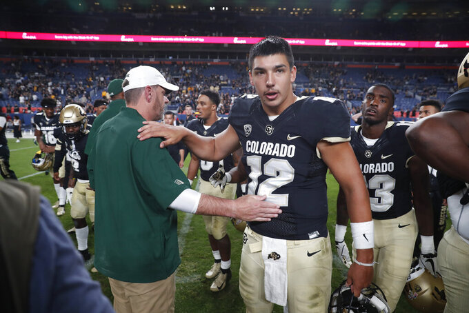 Colorado quarterback Steven Montez, right, congratulates Colorado State head coach Mike Bobo after the fourth quarter of an NCAA college football game Friday, Aug. 30, 2019, in Denver. Colorado won 52-31. (AP Photo/David Zalubowski)