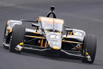Rinus VeeKay, of the Netherlands, drives through the first turn during qualifications for the Indianapolis 500 auto race at Indianapolis Motor Speedway in Indianapolis, Saturday, May 22, 2021. (AP Photo/Michael Conroy)