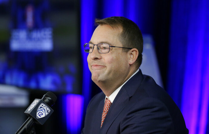 Stanford head coach Jerod Haase smiles at reporters during the Pac-12 NCAA college basketball media day Thursday, Oct. 11, 2018, in San Francisco. (AP Photo/Eric Risberg)