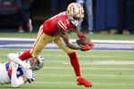 Dallas Cowboys cornerback Anthony Brown (30) stops San Francisco 49ers' Brandon Aiyuk (11) from gaining extra yardage after catching a pass in the second half of an NFL football game in Arlington, Texas, Sunday, Dec. 20, 2020. (AP Photo/Michael Ainsworth)