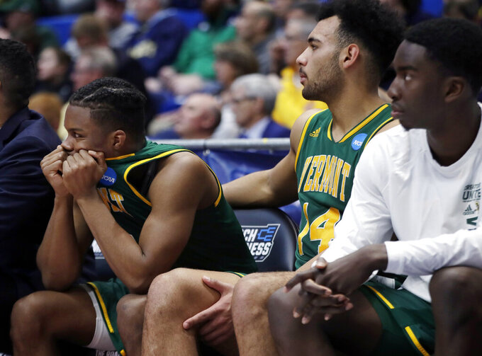 Vermont's Stef Smith, left, and Isaiah Moll (14) react on the bench during the second half of a first round men's college basketball game in the NCAA Tournament, Thursday, March 21, 2019, in Hartford, Conn. Florida State won 76-69. (AP Photo/Elise Amendola)