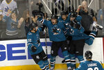 San Jose Sharks right wing Joonas Donskoi, center, celebrates with teammates after scoring a goal in the final seconds of the third period against the Arizona Coyotes in an NHL hockey game Saturday, Jan. 13, 2018, in San Jose, Calif. (AP Photo/Tony Avelar)