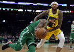 Boston Celtics guard Kyrie Irving drives against Los Angeles Lakers forward Brandon Ingram in the first quarter of an NBA basketball game, Thursday, Feb. 7, 2019, in Boston. (AP Photo/Elise Amendola)