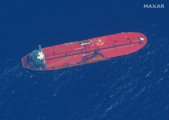 This satellite image provided by Maxar Technologies shows the oil tanker Front Altair off the coast of Fujairah, United Arab Emirates, Monday, June 17, 2019. New satellite photos released Monday show two oil tankers apparently attacked in the Gulf of Oman last week. The U.S. alleges Iran used limpet mines to strike the two tankers. Iran has denied being involved. (Satellite image ©2019 Maxar Technologies via AP)
