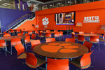 This Jan. 31, 2017 photo, shows a dining area inside the Clemson Football Facility at Clemson University in Clemson, S.C. When it comes to facilities in the ACC, Clemson has set the standard.  The Tigers opened a $55 million team headquarters two years ago that includes a miniature golf course, a slide and a nap room. With the team pursuing its fourth straight ACC title and College Football Playoff berth, they feel the investment is paying off. (Ken Ruinard/The Independent-Mail via AP)