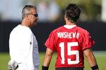 Jacksonville Jaguars head coach Urban Meyer, left, talks with quarterback Gardner Minshew (15) during NFL football practice, Friday, Aug. 6, 2021, in Jacksonville, Fla. (AP Photo/John Raoux)