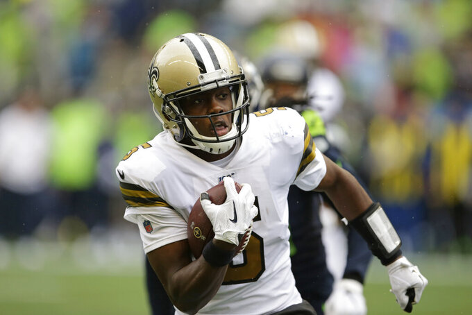 New Orleans Saints quarterback Teddy Bridgewater carries the ball against the Seattle Seahawks during the second half of an NFL football game Sunday, Sept. 22, 2019, in Seattle. (AP Photo/Scott Eklund)