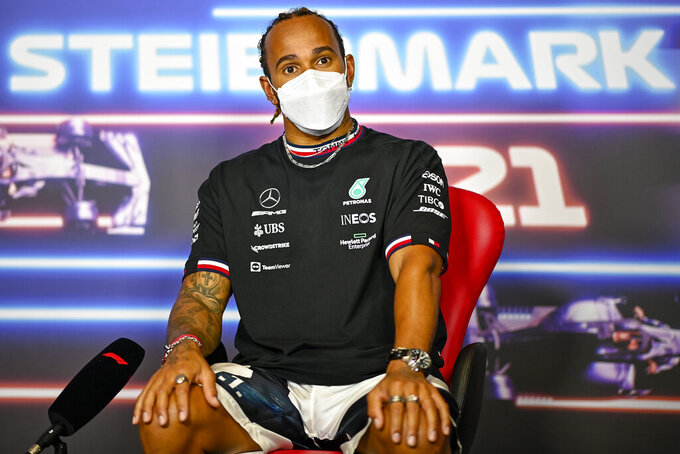 Mercedes driver Lewis Hamilton of Britain attends a news conference at the Red Bull Ring racetrack in Spielberg, Austria, Thursday, June 24, 2021. The Styrian Formula One Grand Prix will be held on Sunday, June 27, 2021. (Christian Bruna/Pool via AP)