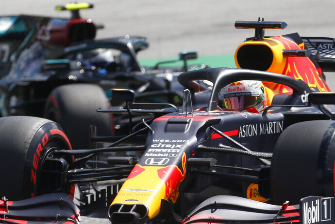 Red Bull driver Max Verstappen of the Netherlands steers his car followed by Mercedes driver Valtteri Bottas of Finland during the qualifying session at the Red Bull Ring racetrack in Spielberg, Austria, Saturday, July 4, 2020. The Austrian Formula One Grand Prix will be held on Sunday. (AP Photo/Darko Bandic)