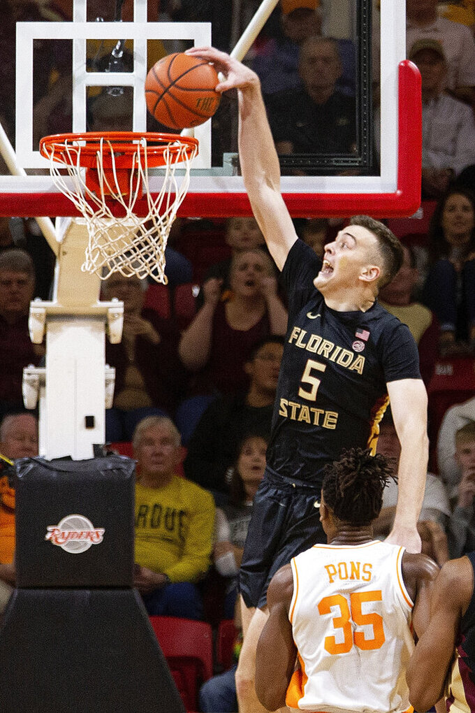 Florida State center Balsa Koprivica (5) dunks in the first half of an NCAA college basketball game against Tennessee at the Emerald Coast Classic in Niceville, Fla., Friday, Nov. 29, 2019. (AP Photo/Mark Wallheiser)