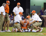 Clemson quarterback Kelly Bryant (2) is helped up by members of the team after being knocked down on a play during the first half of an NCAA college football game against Auburn, Saturday, Sept. 9, 2017, in Clemson, S.C. (AP Photo/Rainier Ehrhardt)