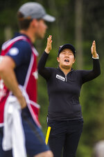 Ruixin Liu of China gets frustrated at officials while playing in the second round of the Dow Great Lakes Bay Invitational golf tournament on Thursday, July 18, 2019 at Midland Country Club in Midland, Mich. (Katy Kildee/Midland Daily News via AP)