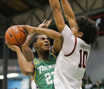 Tulane guard R.J. McGee (23) is guarded by Temple forward Jake Forrester (10) during the first half of an NCAA college basketball game Wednesday, Feb. 12, 2020, in New Orleans. (David Grunfeld/The Advocate via AP)