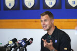 Duke associate head coach Jon Scheyer takes questions during the team's NCAA college basketball media day in Durham, N.C., Tuesday, Sept. 28, 2021. (AP Photo/Gerry Broome)