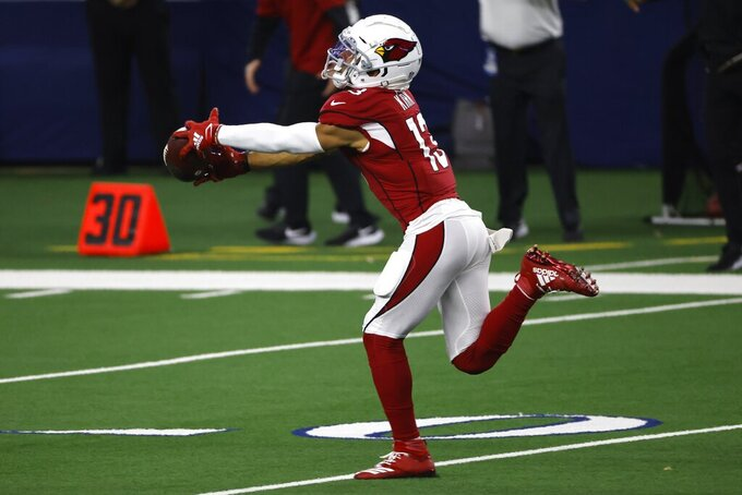 Arizona Cardinals wide receiver Christian Kirk (13) catches a long pass and runs it for a touchdown in the first half of an NFL football game against the Dallas Cowboys in Arlington, Texas, Monday, Oct. 19, 2020. (AP Photo/Ron Jenkins)