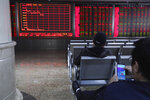 Investors monitor stock prices at a brokerage in Beijing, China, Tuesday, March 19, 2019. Asian shares were mixed in muted trading Tuesday as investors awaited the U.S. Federal Reserve meeting later in the week. (AP Photo/Ng Han Guan)