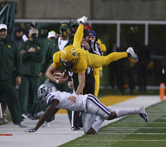 Baylor quarterback Charlie Brewer is upended by Kansas State defensive back Kiondre Thomas during the second half of an NCAA college football game Saturday, Nov. 28, 2020, in Waco, Texas. (Rod Aydelotte/Waco Tribune Herald via AP)