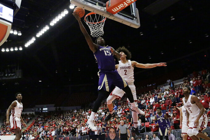 Washington forward Noah Dickerson (15) shoots in front of Washington State forward CJ Elleby (2) during the second half of an NCAA college basketball game in Pullman, Wash., Saturday, Feb. 16, 2019. (AP Photo/Young Kwak)